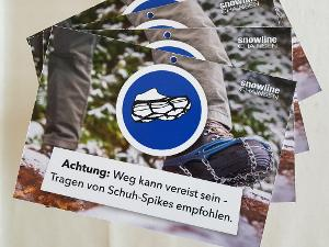 snowline sign: 'spikes recommended' GERMAN ONLY